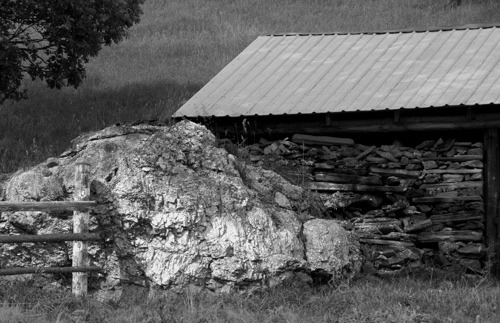 Granite Boulder, Fence, and Wood Shed on Pennington County Road 233 (black and white)
